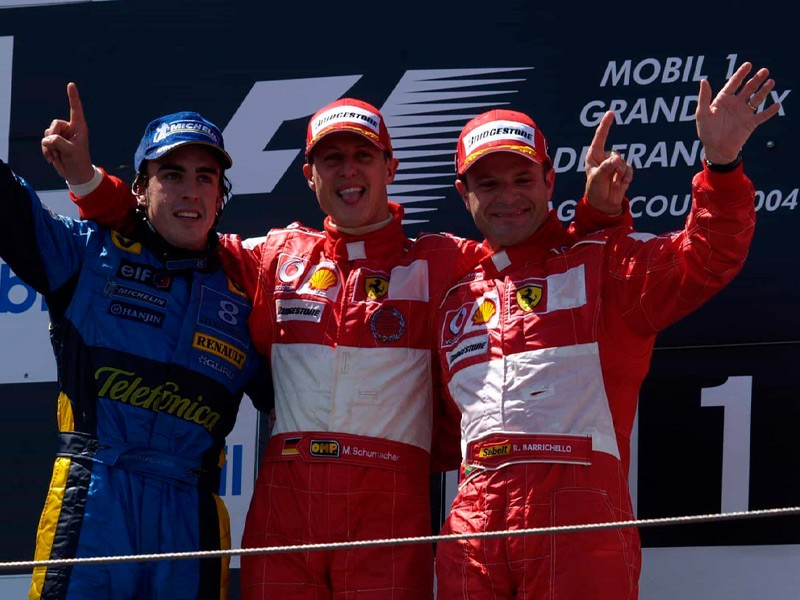 Fernando Alonso on the 2004 French GP podium