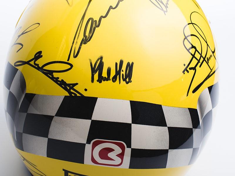 Ferrari helmet signed by Ferrari F1 drivers.